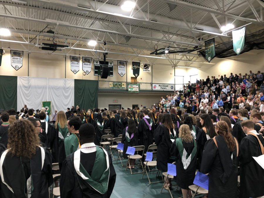 Class+of+2018+graduates+received+their+hoods+on+May+18.+Photo+credit%3A+Justin+Kucharski