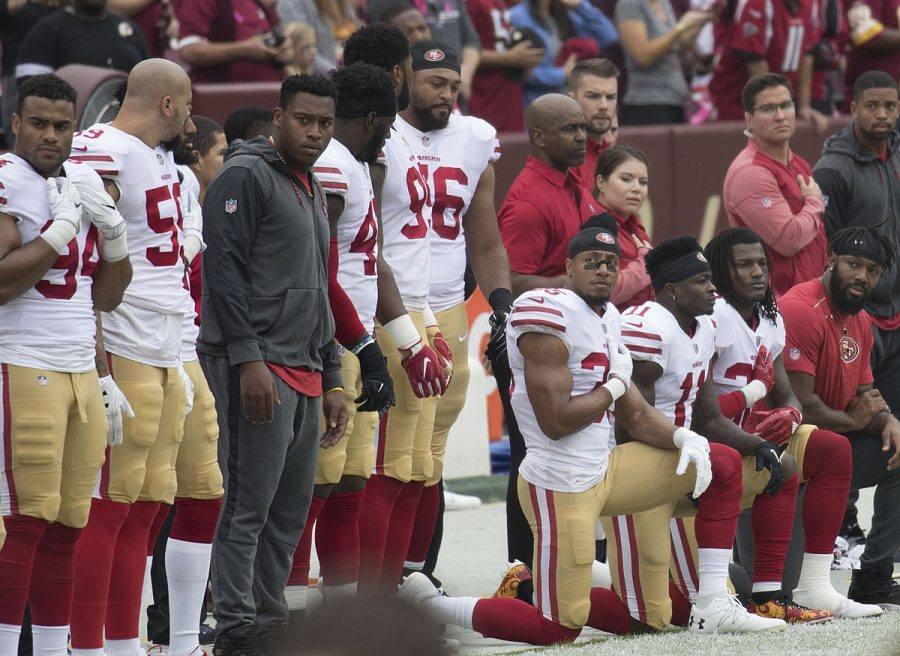 Some members of the San Francisco 49ers kneel during the National Anthem. Photo via Wikimedia Commons under Creative Commons license.