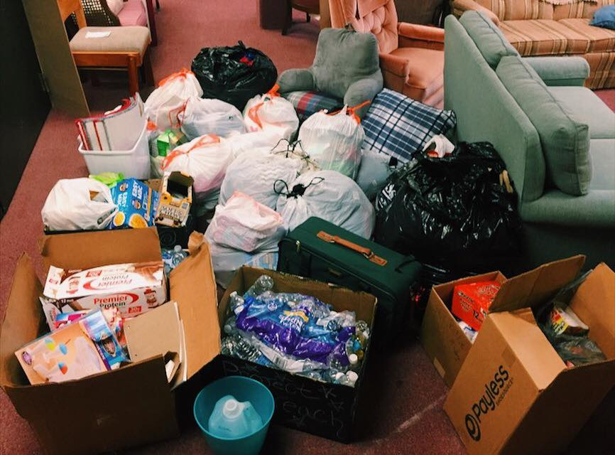 Project Outreach volunteers sort a variety of donations into categories before taking them to charities. Photo courtesy of Carley Sliwka