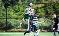 Zac Lloyd gets up high to head a ball. Photo courtesy of Marywood Athletics