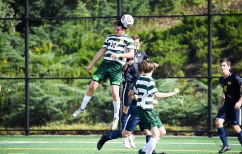 Zac Lloyd gets up high to head a ball. Photo courtesy of Marywood Athletics