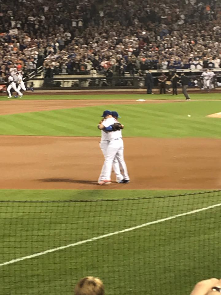 David Wright and Jose Reyes embrace just before the game begins.