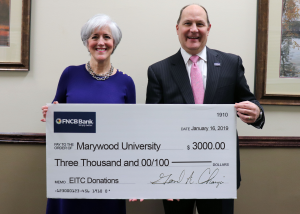 Patricia Rosetti, Leadership Annual Giving Officer, accepted the $3,000 donation from Jerry Champi, FNCB Bank President and CEO, to help further the Momentum Program. IMAGE CREDIT: Marywood University's Marketing & Communications Department