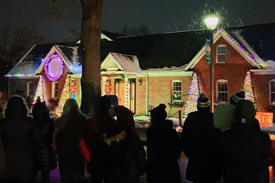 Students gathered outside of the Printing and Mailing Center to watch Marywood's first ever light show on Dec. 4. Photo credit: Katie Warnokowski