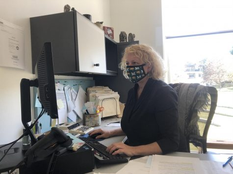 Mary Kay Maldonato, interlibrary loan clerk, works in her office in the Learning Commons. Due to COVID-19, safety protocols such as mandatory masks have been implemented at the Learning Commons.