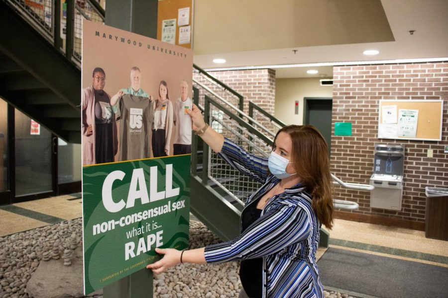 Student therapist for the counseling center, Dalice Hess, displays posters for Marywood University's