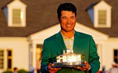 Hideki Matsuyama dons the iconic green jacket after his historic win at the Masters Tournament.