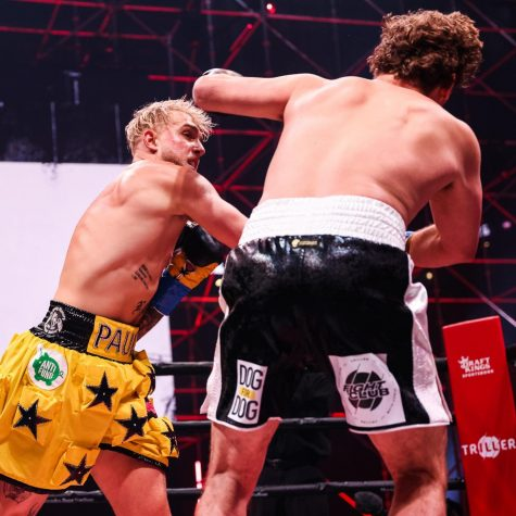 Jake Paul and Ben Askren face-off during Triller Fight Club at Mercedes-Benz Stadium.