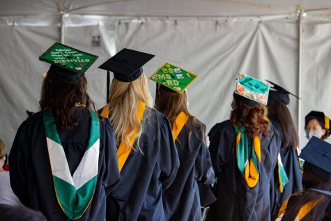 Students wait to receive their diplomas at the first of four commencement ceremonies.